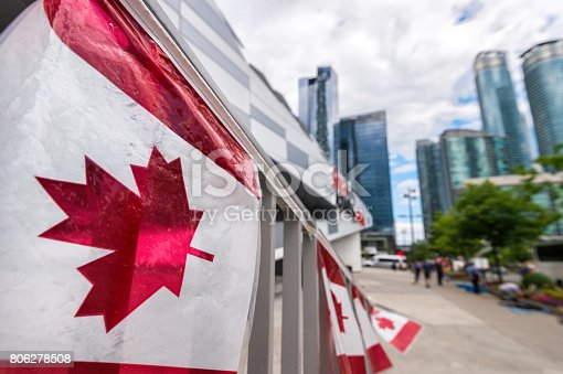 istock Canada plastic flag with blurred urban background in Toronto 806278508