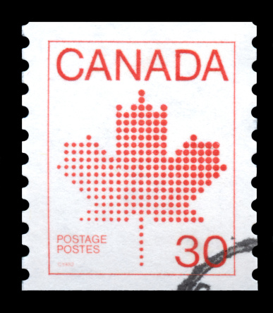 Canada postage stamp showing the red maple leaf, the symbol of Canada