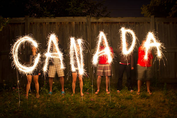 canada sparklers in time lapse photography - canada day stock pictures, royalty-free photos & images