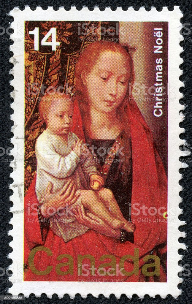 Canada stamp shows Painting Virgin and Child stock photo