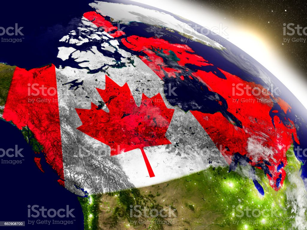 Canada with flag in rising sun stock photo