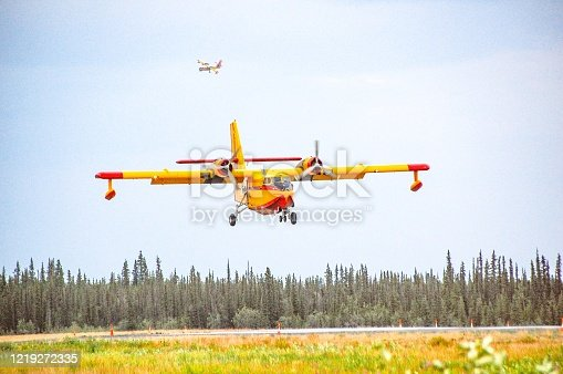 Firefighting in Alaska is being assisted by a Canadian force. This Canadian CL-415 is a very affective too in fighting fires. These planes have the ability to scoop up water and drop a water bomb to help fight fires. This bright yellow plane makes an impressive entrance to Alaska. Landing in Interior Alaska to refuel, it was a great opportunity to view this plane..