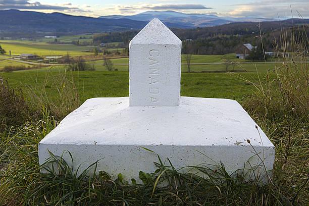 Canada's boundary stone stock photo