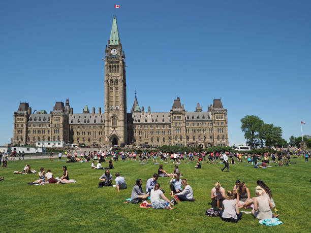 canada's federal  parliament building is a friendly place, with picnics and aerobics on the front lawn. - canada parliament stock photos and pictures