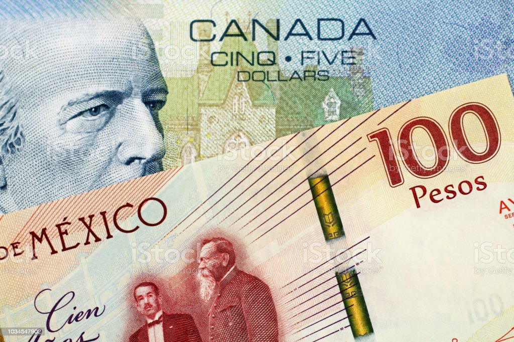 A Canadian 5 Dollar Bill With A Mexican 100 Peso Note Stock