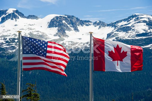 istock Canadian and American flags 508632322