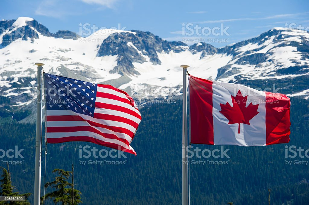 Canadian and American flags stock photo