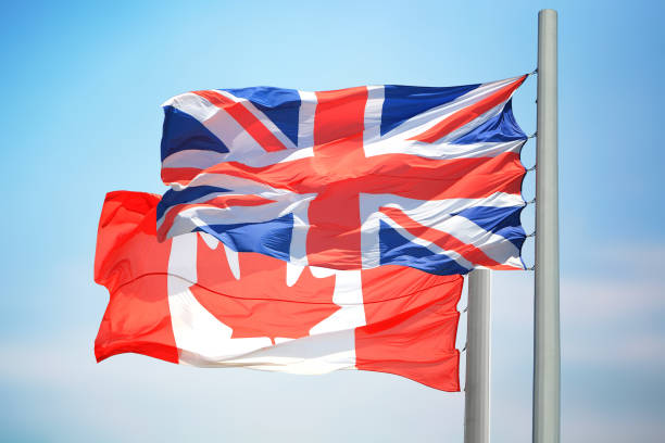 Canadian and British flags stock photo