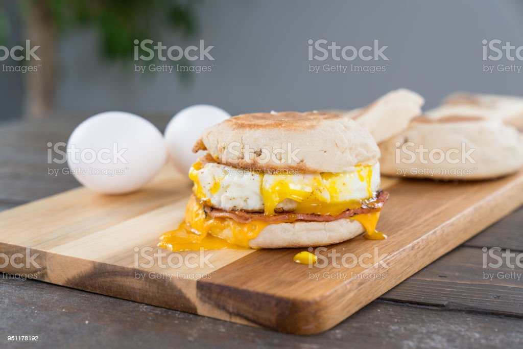 Canadian Bacon, Egg and Cheese Breakfast Sandwich with Yoke stock photo