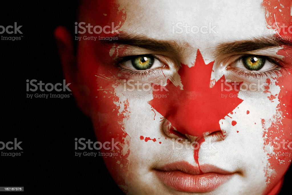 Canadian boy with the flag of Canada royalty-free stock photo