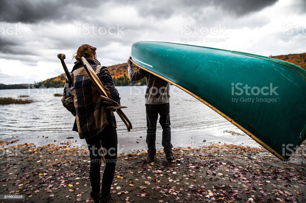Canadian couple spending holidays together canoeing at park stock photo