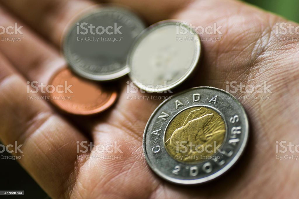 Canadian currency in hand stock photo