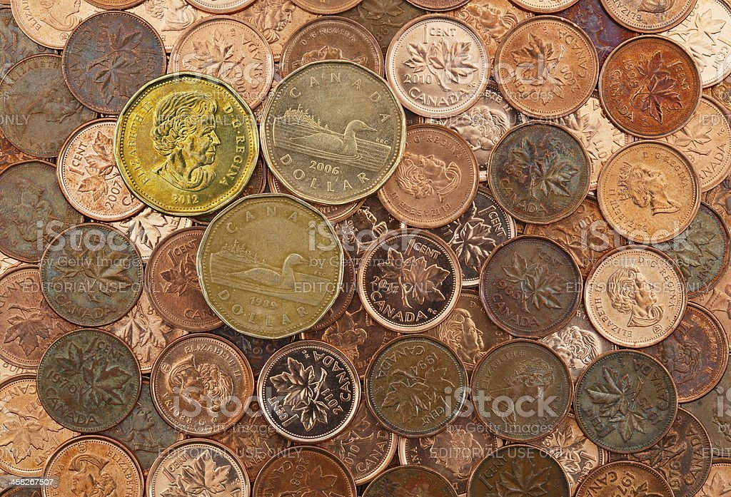 Canadian Dollar Coins On A Bed Of Pennies stock photo
