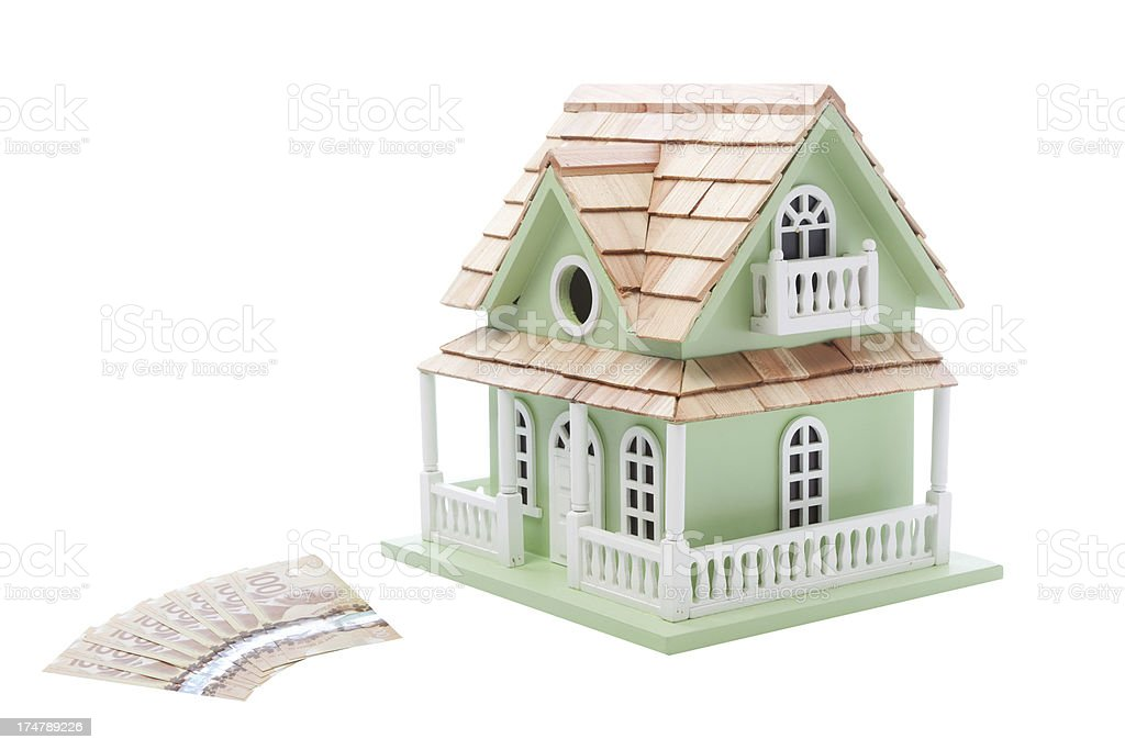 Canadian dollars and model house for real estate concept royalty-free stock photo