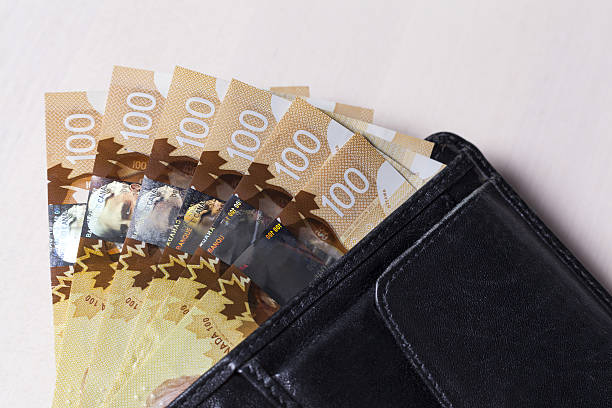 Canadian Dollars in a open black leather wallet stock photo