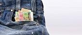 istock Canadian dollars money in blue denim jeans pocket 478124438