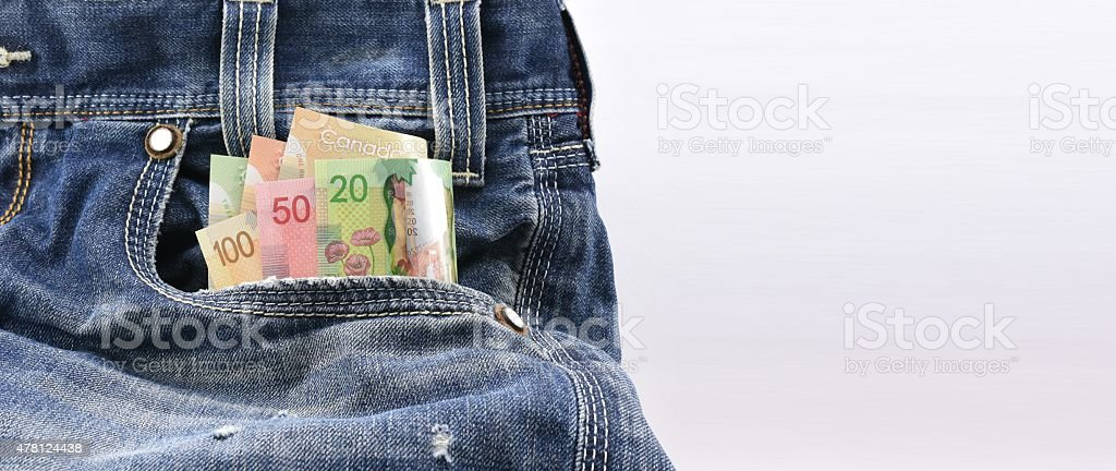 Canadian dollars money in blue denim jeans pocket stock photo