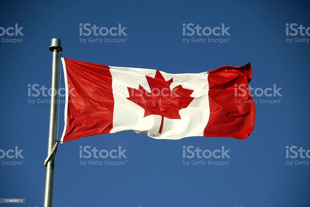 Canadian Flag Against Blue Sky royalty-free stock photo