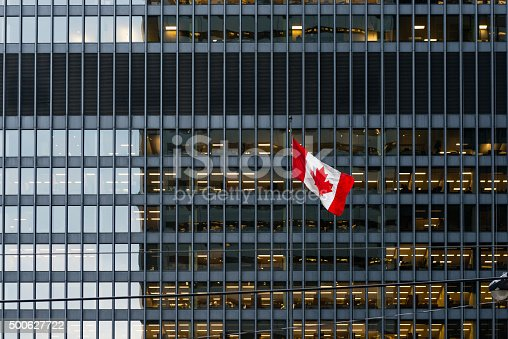 500627722 istock photo Canadian flag and modern office building in downtown Toronto 500627722