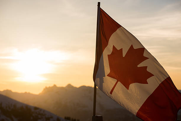 Canadian Flag at sunset Canadian flag in the mountains at sunset canada flag photos stock pictures, royalty-free photos & images