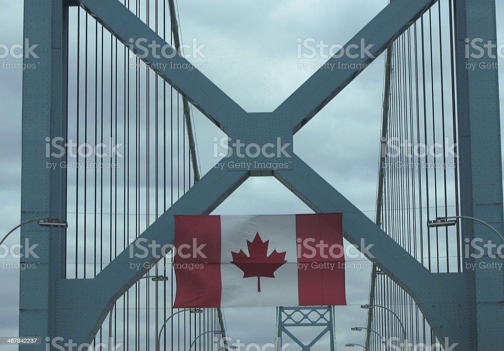 Canadian flag hanging on Ambassador bridge. stock photo