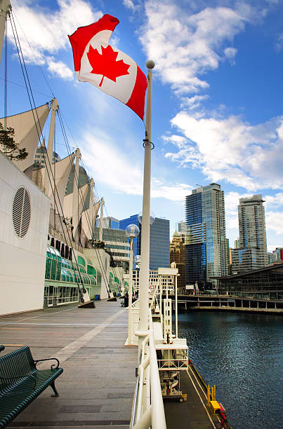 Canadian flag in front of  Vancouver, Canada. stock photo