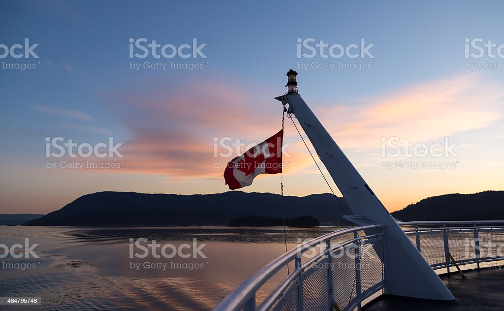 Canadian flag on the stern of a ferry stock photo