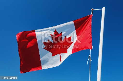 Canadian flag in afternoon sunlight.