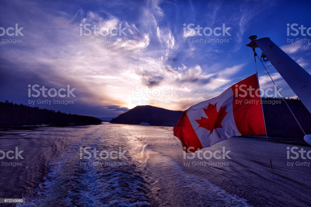 Canadian flag waving at sunset at sea,Vancouver,Canada stock photo