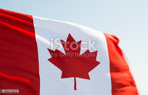 istock Canadian flag waving in the wind 811741114