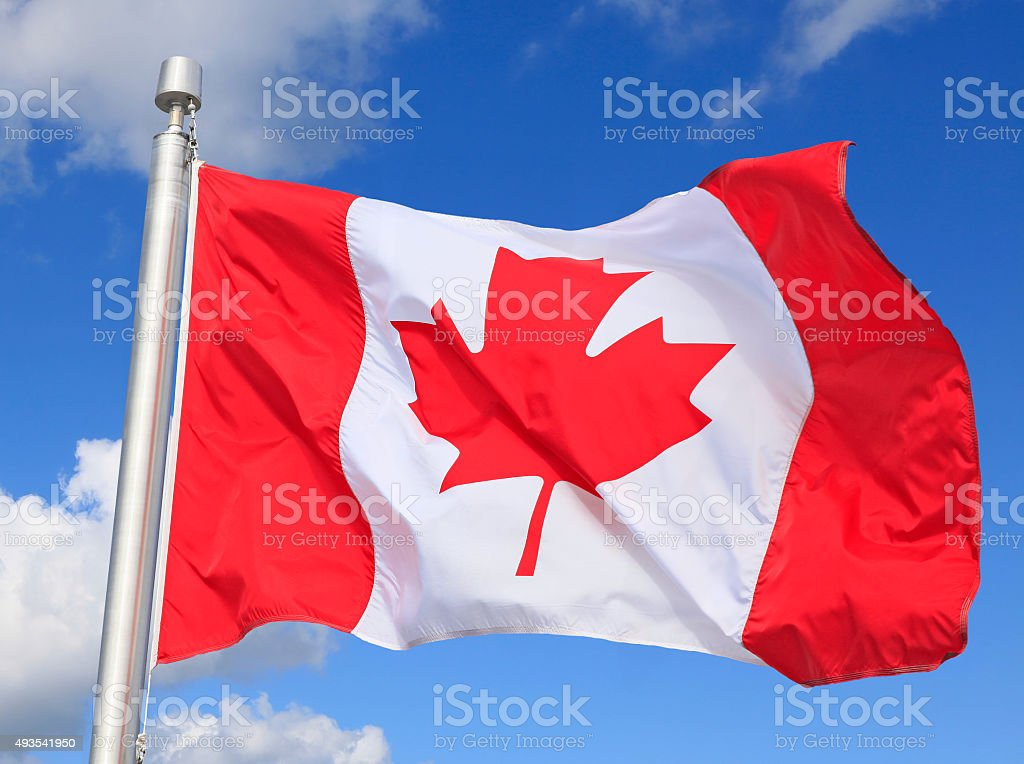 Canadian flag waving on the wind stock photo
