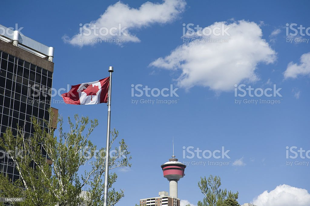 Canadian flag with Calgary tower seen from central memorial park stock photo