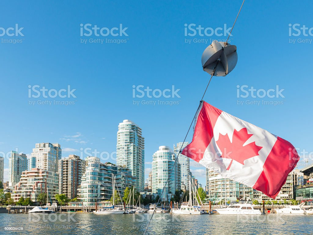 Canadian Flag with False Creek Bay Buildings Vancouver Cityscape stock photo