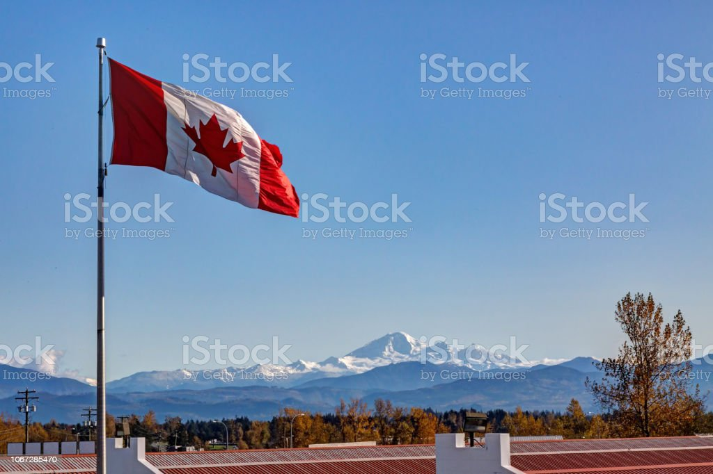 Canadian Flag with Mt. Baker in the background stock photo