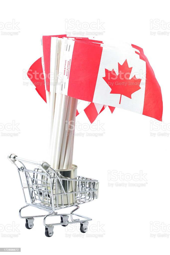 Canadian Flags in shopping cart royalty-free stock photo