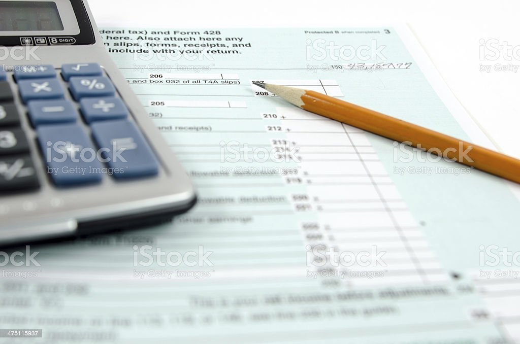 Canadian Income Tax Form...Calculator stock photo