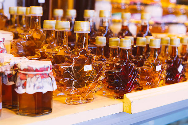 canadian maple syrup bottles for sale atwater market montreal export - maple syrup stock photos and pictures