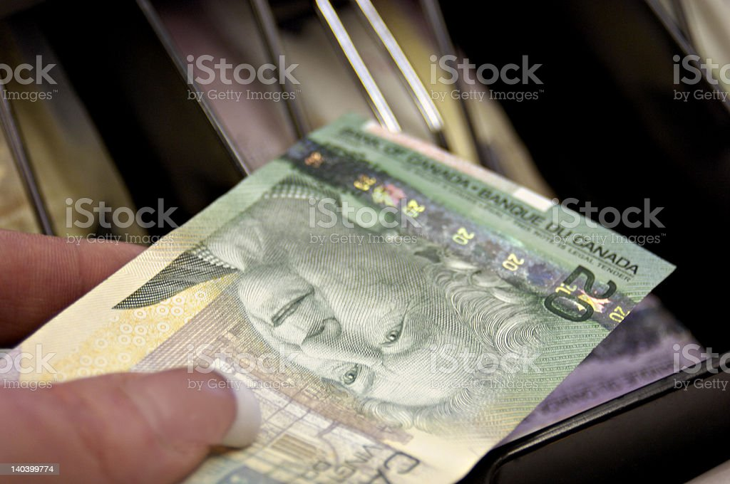 Canadian Money and Cash Register royalty-free stock photo