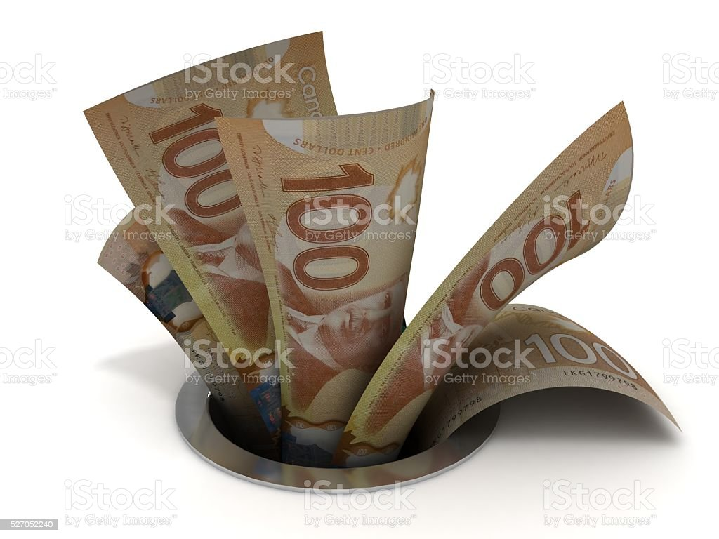 Canadian money down the drain concept stock photo