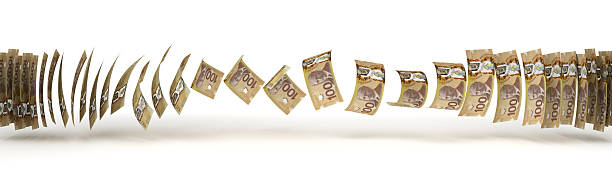 Canadian Money swaying to the side in a line stock photo