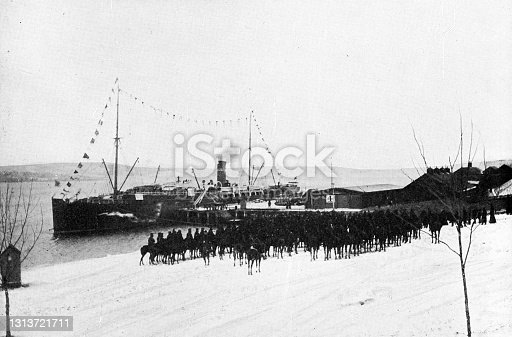 The Canadian Mounted Rifles boarding the SS Pomeranian in Halifax, Nova Scotia, Canada leaving for the Second Boer War in South Africa. Vintage etching circa 19th century.