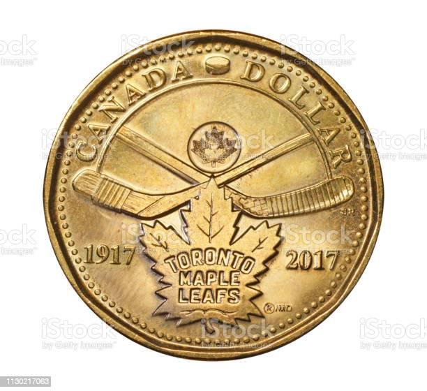 Canadian one dollar coin known as loonie commemorating  100th anniversary  the Toronto Maple Leafs hockey team