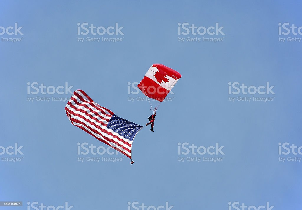 Canadian parachutist with US flag royalty-free stock photo