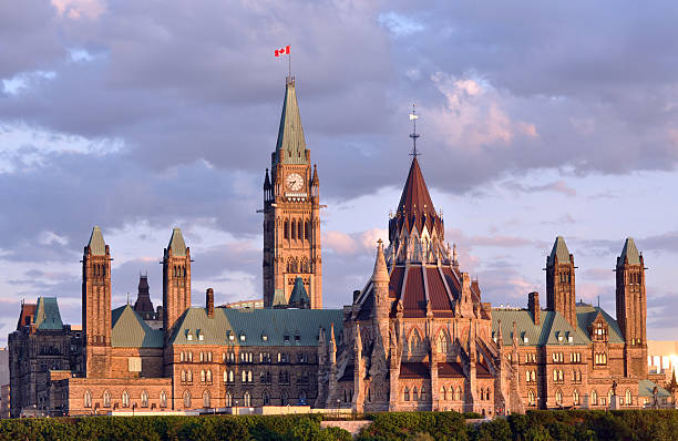 canadian parliament building at dusk - canada parliament stock photos and pictures