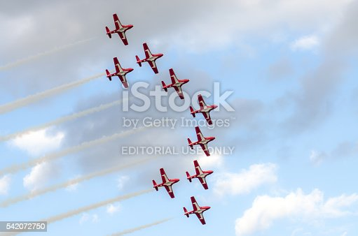 Quebec, Canada - June 15, 2016: Nine Canadian Snowbirds aircraft flying over Terrace Dufferin during day of summer with sky as background