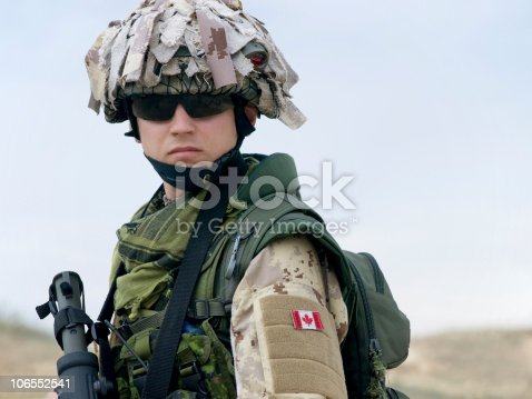 istock A Canadian soldier in a camouflaged uniform with a gun 106552541