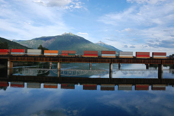 canadian train on a railwaybridge - godståg bildbanksfoton och bilder