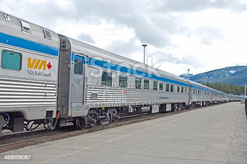 Jasper, Alberta - May 6, 2011: The cars of a Canadian VIA Rail passenger train at the train station in Jasper, Alberta. Jasper is in the Rocky Mountains. Via Rail is a government operated train in Canada. There are 480 VIA trains operating in the provinces with the main office in Montreal, Quebec.
