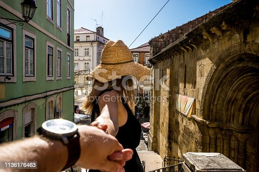 istock Canadian Woman holding her husband's hand in Coimbra 1136176463