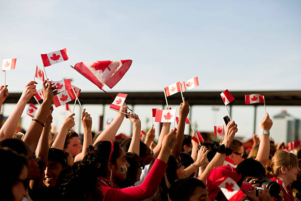 canadians waving flags, patriotism - canada day stock pictures, royalty-free photos & images